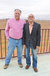 Bobby and Vijay Reddy, standing in front of Vijay's vineyard, one of the largest in the state.